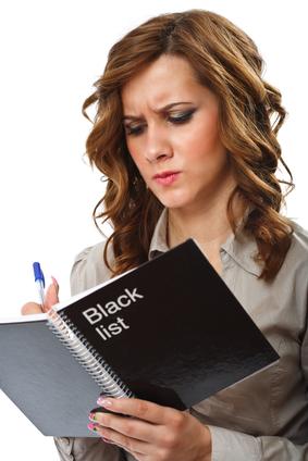 Businesswoman writing a black list